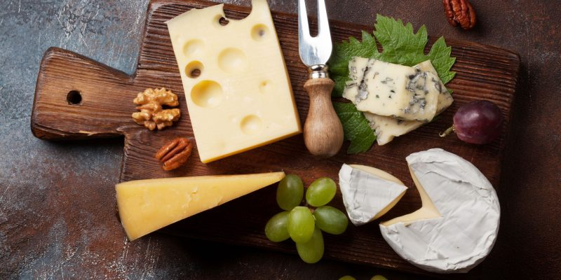 Cheese board with grapes and nuts. Wine snaks. Top view